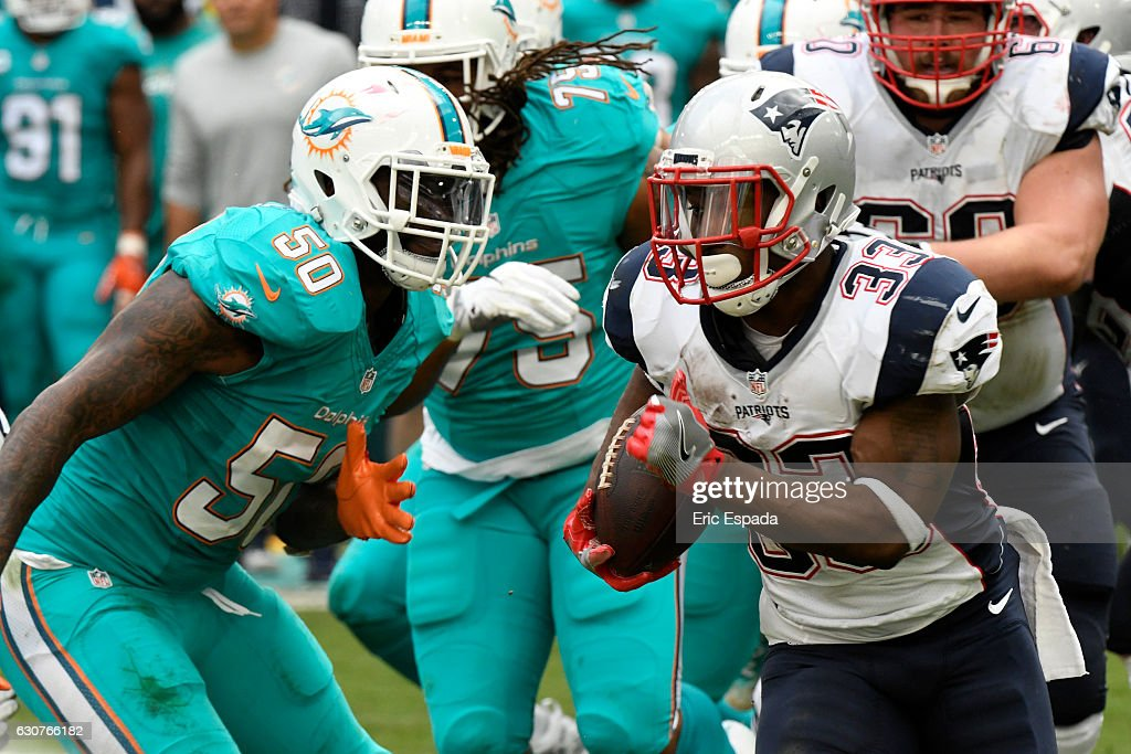 Dion Lewis #33 of the New England Patriots rushes the football during the second quarter against the Miami Dolphins at Hard Rock Stadium on January 1, 2017 in Miami Gardens, Florida.