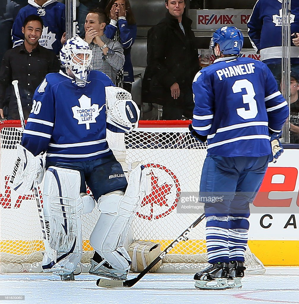 Dion Phaneuf #3 and Ben Scrivens #30 of the Toronto Maple Leafs celebrate a 3-0 win against the Ottawa Senators during NHL action at the Air Canada Centre February 16, 2013 in Toronto, Ontario, Canada.