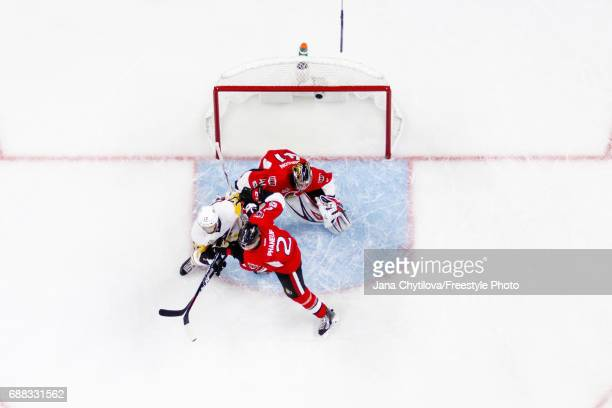 Dion Phaneuf and Craig Anderson of the Ottawa Senators defend against Bryan Rust of the Pittsburgh Penguins in Game Six of the Eastern Conference...