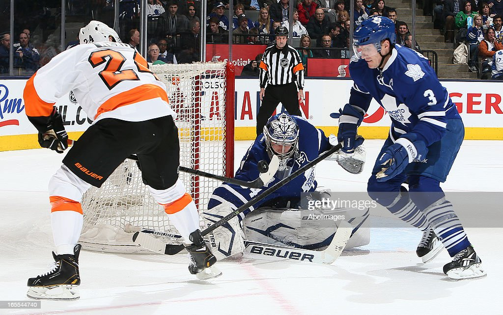 <a gi-track='captionPersonalityLinkClicked' href=/galleries/search?phrase=Dion+Phaneuf&family=editorial&specificpeople=545455 ng-click='$event.stopPropagation()'>Dion Phaneuf</a> #3 and James Reimer #34 of the Toronto Maple Leafs scramble for a loose puck in front of <a gi-track='captionPersonalityLinkClicked' href=/galleries/search?phrase=Matt+Read&family=editorial&specificpeople=6783206 ng-click='$event.stopPropagation()'>Matt Read</a> #24 of the Philadelphia Flyers during NHL action at the Air Canada Centre April 4, 2013 in Toronto, Ontario, Canada.