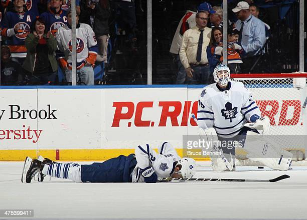 Dion Phaneuf and Jonathan Bernier of the Toronto Maple Leafs lie on the ice following a 54 overtime loss to the New York Islanders at the Nassau...