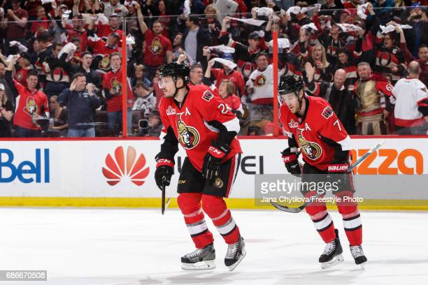 Dion Phaneuf and Kyle Turris of the Ottawa Senators celebrate a second period goal by teammate Clarke MacArthur 4against the Pittsburgh Penguins in...