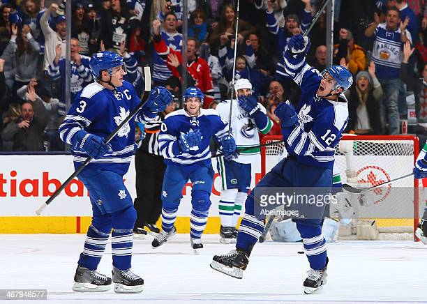 Dion Phaneuf and Mason Raymond of the Toronto Maple Leafs celebrate Raymond's goal against the Vancouver Canucks during NHL action at the Air Canada...
