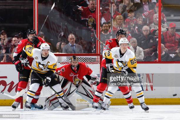 Dion Phaneuf Craig Anderson and Cody Ceci of the Ottawa Senators defend against Sidney Crosby and Jake Guentzel of the Pittsburgh Penguins in the...