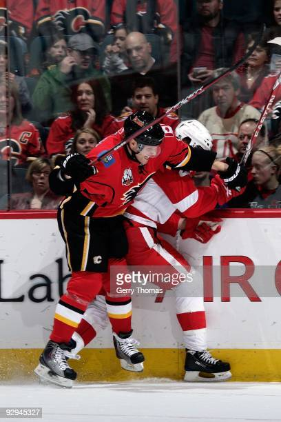 Dion Phaneuf of the Calgary Flames checks Todd Bertuzzi of the Detroit Red Wings on October 31 2009 at Pengrowth Saddledome in Calgary Alberta Canada...