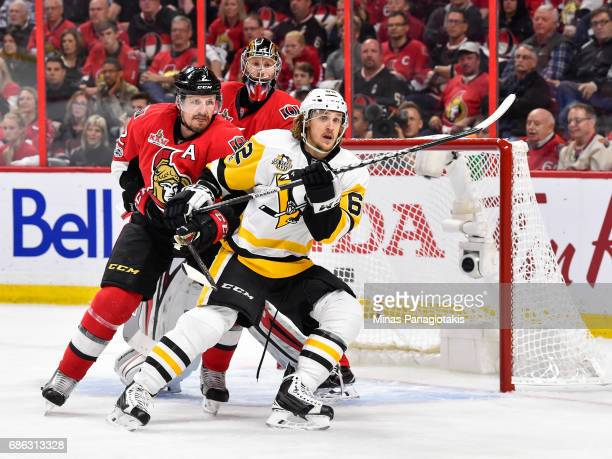 Dion Phaneuf of the Ottawa Senators and Carl Hagelin of the Pittsburgh Penguins battle for position near goaltender Craig Anderson in Game Four of...