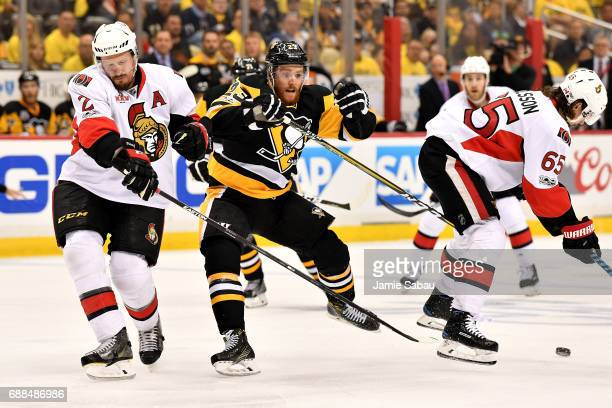 Dion Phaneuf of the Ottawa Senators and Scott Wilson of the Pittsburgh Penguins collide during the second period in Game Seven of the Eastern...