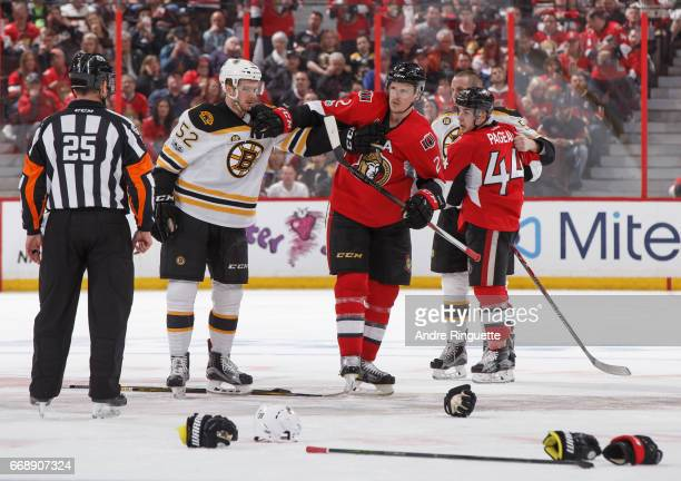Dion Phaneuf of the Ottawa Senators and Sean Kuraly of the Boston Bruins grab a hold of each other during a scrum in Game Two of the Eastern...