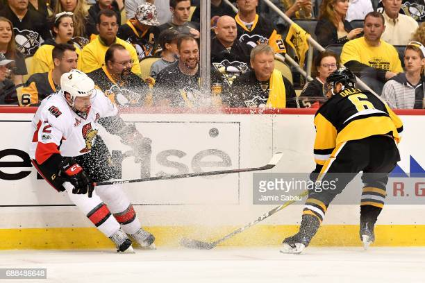 Dion Phaneuf of the Ottawa Senators and Trevor Daley of the Pittsburgh Penguins fight for the puck during the second period in Game Seven of the...