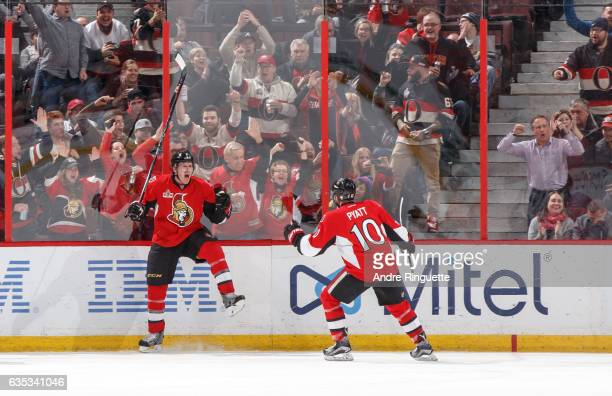Dion Phaneuf of the Ottawa Senators celebrates his second period goal against the Buffalo Sabres with teammate Tom Pyatt at Canadian Tire Centre on...