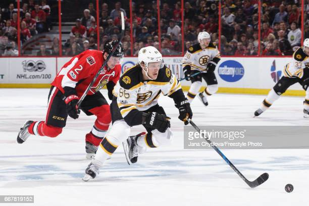 Dion Phaneuf of the Ottawa Senators chases a breaking David Pastrnak of the Boston Bruins in Game One of the Eastern Conference First Round during...
