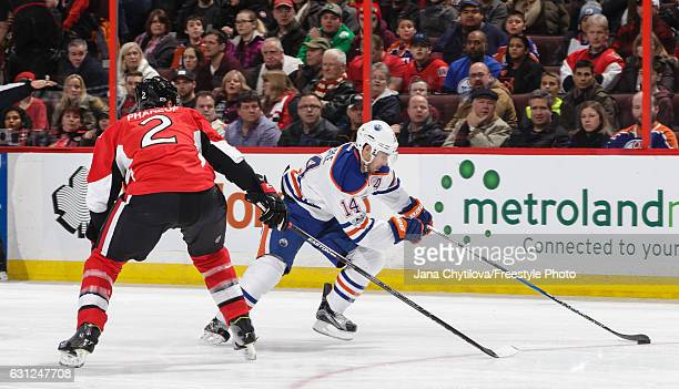 Dion Phaneuf of the Ottawa Senators defends against a puck carrying Jordan Eberle of the Edmonton Oilers at Canadian Tire Centre on January 8 2017 in...