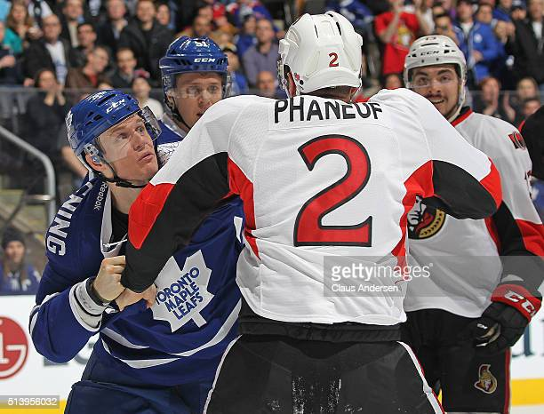 Dion Phaneuf of the Ottawa Senators fights Colin Greening of the Toronto Maple Leafs during an NHL game at the Air Canada Centre on March 52016 in...