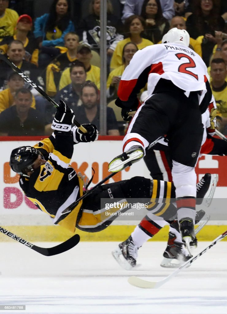 Dion Phaneuf #2 of the Ottawa Senators hits Bryan Rust #17 of the Pittsburgh Penguins during the first period in Game Two of the Eastern Conference Final during the 2017 NHL Stanley Cup Playoffs at PPG PAINTS Arena on May 15, 2017 in Pittsburgh, Pennsylvania.