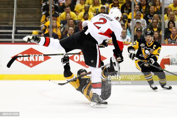 Dion Phaneuf of the Ottawa Senators hits Bryan Rust of the Pittsburgh Penguins during the first period in Game Two of the Eastern Conference Final...