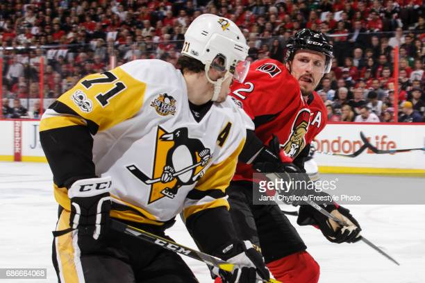 Dion Phaneuf of the Ottawa Senators lines up Evgeni Malkin of the Pittsburgh Penguins for a check in Game Four of the Eastern Conference Final during...