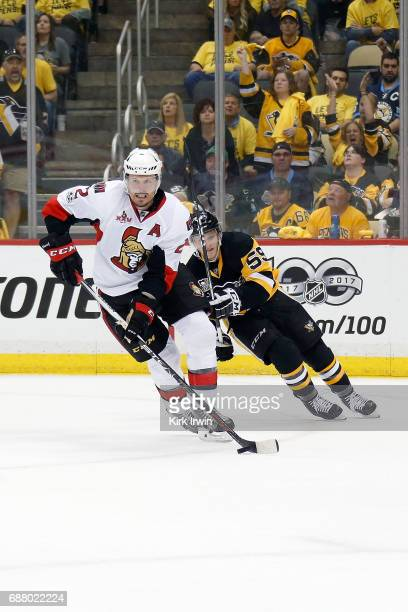 Dion Phaneuf of the Ottawa Senators skates the puck away from Jake Guentzel of the Pittsburgh Penguins in Game Five of the Eastern Conference Final...