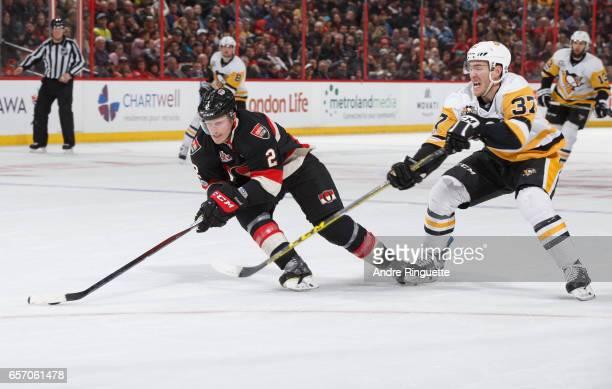 Dion Phaneuf of the Ottawa Senators stickhandles the puck against Carter Rowney of the Pittsburgh Penguins at Canadian Tire Centre on March 23 2017...