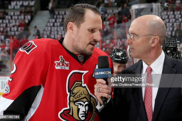 Dion Phaneuf of the Ottawa Senators talks with broadcaster Pierre McGuire prior to Game Six of the Eastern Conference Final against the Pittsburgh...
