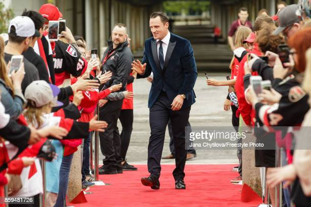 Dion Phaneuf of the Ottawa Senators walks the red carpet prior to the start of a game against the Detroit Red Wings at Canadian Tire Centre on...