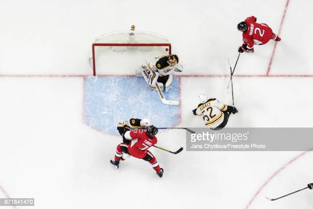 Dion Phaneuf of the Ottawa Senators watches the puck go high over the shoulder of Tuukka Rask of the Boston Bruins as Sean Kuraly and JohnMichael...