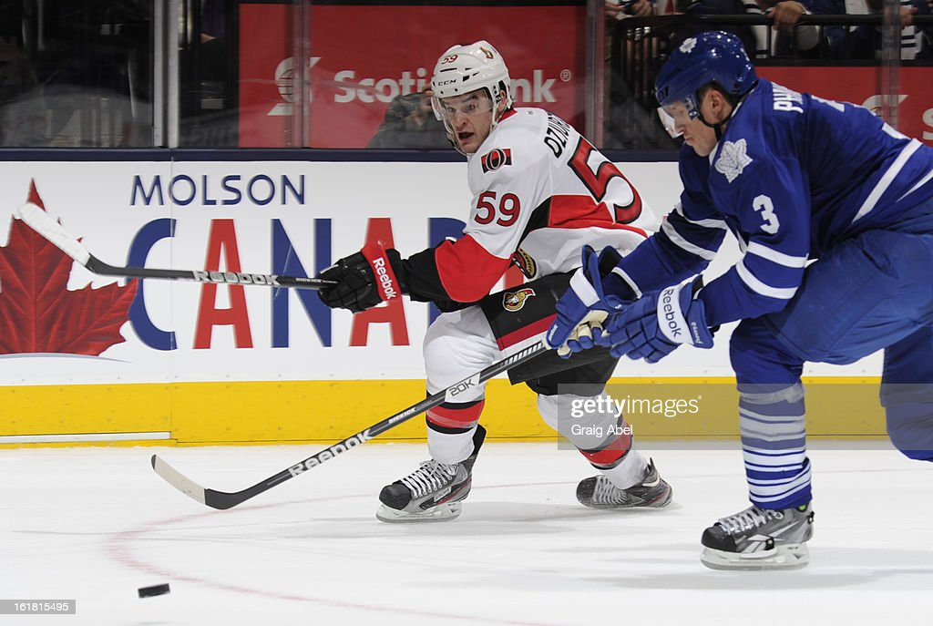 <a gi-track='captionPersonalityLinkClicked' href=/galleries/search?phrase=Dion+Phaneuf&family=editorial&specificpeople=545455 ng-click='$event.stopPropagation()'>Dion Phaneuf</a> #3 of the Toronto Maple Leafs battles for the puck with David Dziurzynski #59 of the Ottawa Senators during NHL game action February 16, 2013 at the Air Canada Centre in Toronto, Ontario, Canada.