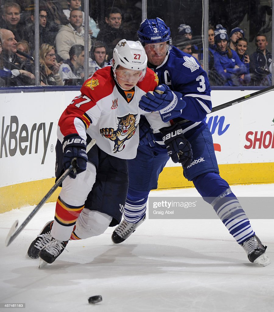 <a gi-track='captionPersonalityLinkClicked' href=/galleries/search?phrase=Dion+Phaneuf&family=editorial&specificpeople=545455 ng-click='$event.stopPropagation()'>Dion Phaneuf</a> #3 of the Toronto Maple Leafs battles for the puck with <a gi-track='captionPersonalityLinkClicked' href=/galleries/search?phrase=Nick+Bjugstad&family=editorial&specificpeople=7029343 ng-click='$event.stopPropagation()'>Nick Bjugstad</a> #27 of the Florida Panthers during NHL game action December 17, 2013 at the Air Canada Centre in Toronto, Ontario, Canada.