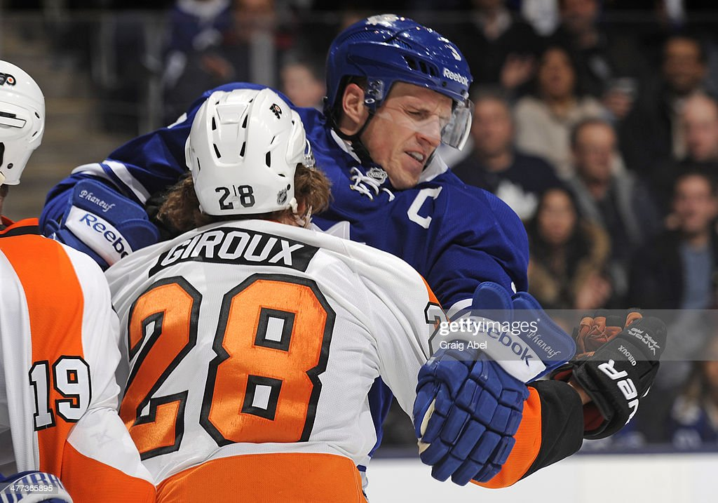 <a gi-track='captionPersonalityLinkClicked' href=/galleries/search?phrase=Dion+Phaneuf&family=editorial&specificpeople=545455 ng-click='$event.stopPropagation()'>Dion Phaneuf</a> #3 of the Toronto Maple Leafs battles with <a gi-track='captionPersonalityLinkClicked' href=/galleries/search?phrase=Claude+Giroux&family=editorial&specificpeople=537961 ng-click='$event.stopPropagation()'>Claude Giroux</a> #28 of the Philadelphia Flyers during NHL game action March 8, 2014 at the Air Canada Centre in Toronto, Ontario, Canada.