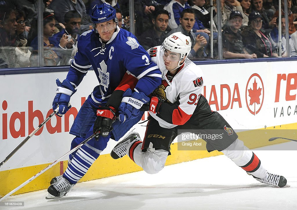 Dion Phaneuf #3 of the Toronto Maple Leafs battles with Mika Zibanejad #93 of the Ottawa Senators during NHL game action February 16, 2013 at the Air Canada Centre in Toronto, Ontario, Canada.