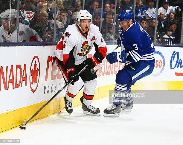 Dion Phaneuf of the Toronto Maple Leafs chases Bobby Ryan of the Ottawa Senators during game action on March 28 2015 at Air Canada Centre in Toronto...