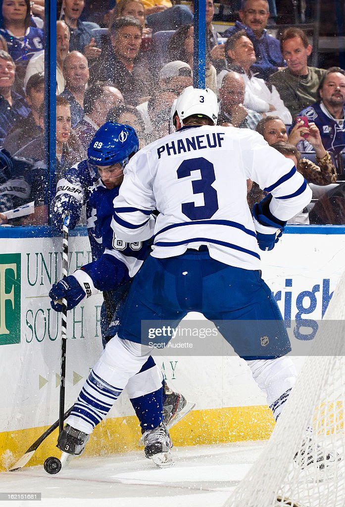 <a gi-track='captionPersonalityLinkClicked' href=/galleries/search?phrase=Dion+Phaneuf&family=editorial&specificpeople=545455 ng-click='$event.stopPropagation()'>Dion Phaneuf</a> #3 of the Toronto Maple Leafs checks Cory Conacher #89 of the Tampa Bay Lightning during the first period of the game at the Tampa Bay Times Forum on February 19, 2013 in Tampa, Florida.