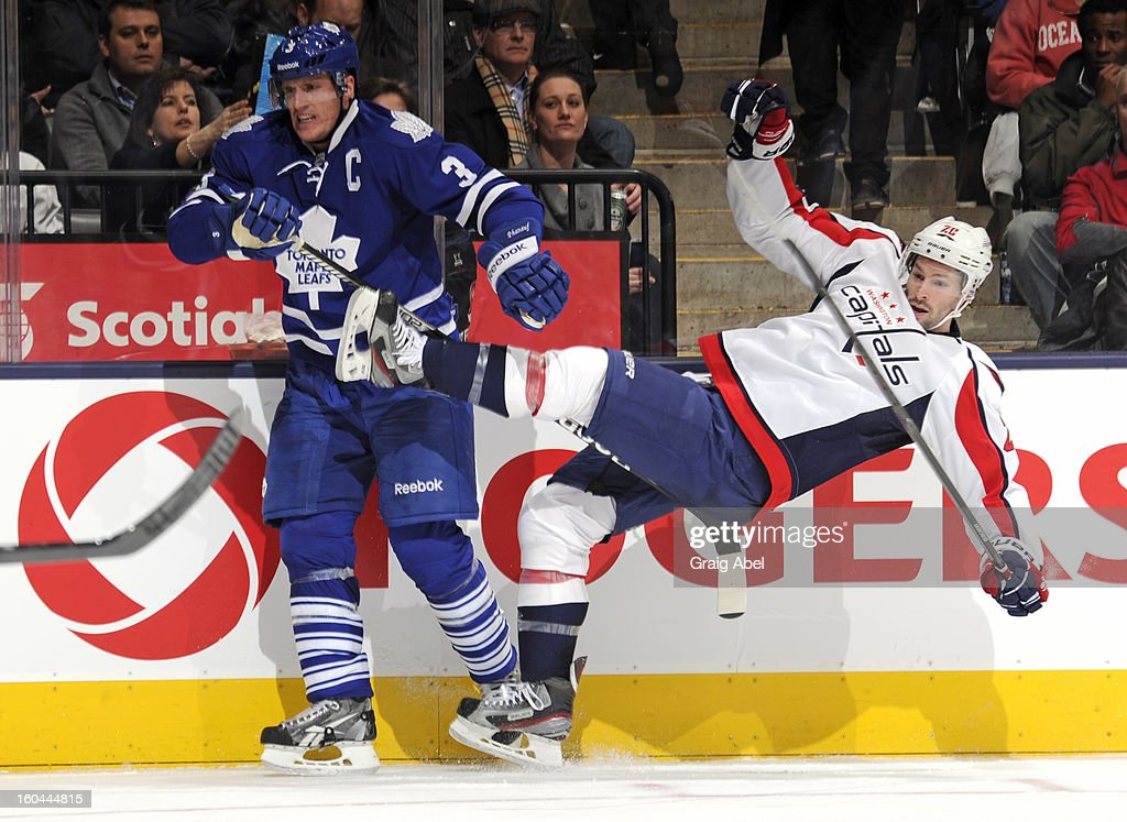 Dion Phaneuf #3 of the Toronto Maple Leafs checks Troy Brouwer #17 of the Washington Capitals during NHL game action January 31, 2013 at the Air Canada Centre in Toronto, Ontario, Canada.