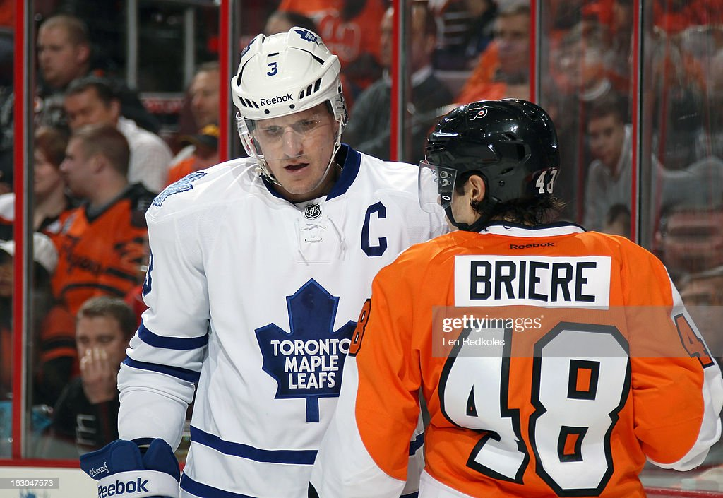 Dion Phaneuf #3 of the Toronto Maple Leafs confronts Danny Briere #48 of the Philadelphia Flyers on February 25, 2013 at the Wells Fargo Center in Philadelphia, Pennsylvania.