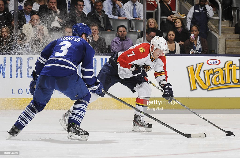 Dion Phaneuf #3 of the Toronto Maple Leafs defends as Dmitry Kulikov #7 of the Florida Panthers looks to shoot the puck during NHL game action March 26, 2013 at the Air Canada Centre in Toronto, Ontario, Canada.
