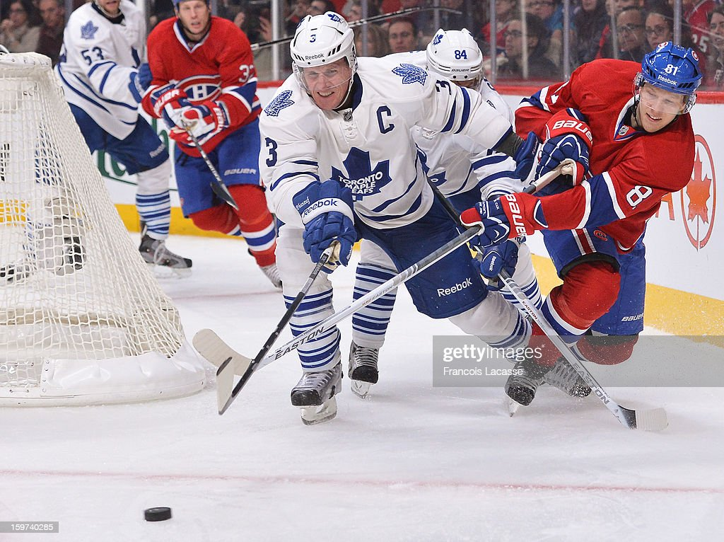 <a gi-track='captionPersonalityLinkClicked' href=/galleries/search?phrase=Dion+Phaneuf&family=editorial&specificpeople=545455 ng-click='$event.stopPropagation()'>Dion Phaneuf</a> #3 of the Toronto Maple Leafs is being chased by LArs Eller #8 of the Montreal Canadiens during the NHL game on January 19, 2013 at the Bell Centre in Montreal, Quebec, Canada.