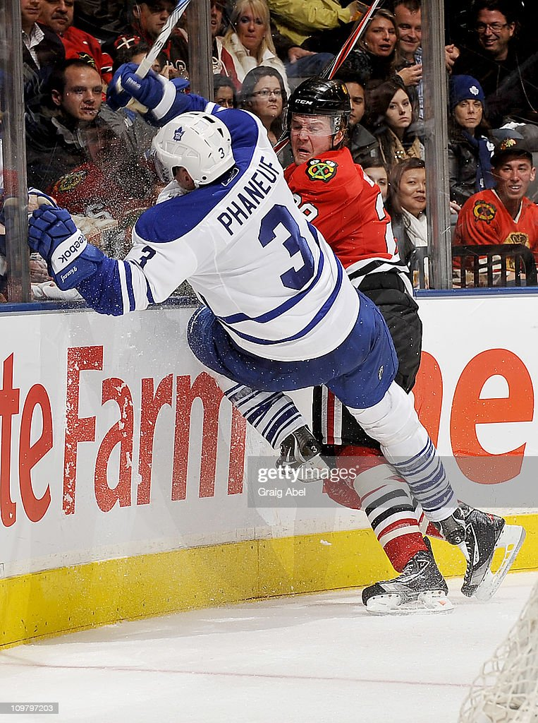 <a gi-track='captionPersonalityLinkClicked' href=/galleries/search?phrase=Dion+Phaneuf&family=editorial&specificpeople=545455 ng-click='$event.stopPropagation()'>Dion Phaneuf</a> #3 of the Toronto Maple Leafs is checked by <a gi-track='captionPersonalityLinkClicked' href=/galleries/search?phrase=Bryan+Bickell&family=editorial&specificpeople=241498 ng-click='$event.stopPropagation()'>Bryan Bickell</a> #29 of the Chicago Blackhawks March 5, 2011 at the Air Canada Centre in Toronto, Ontario, Canada.