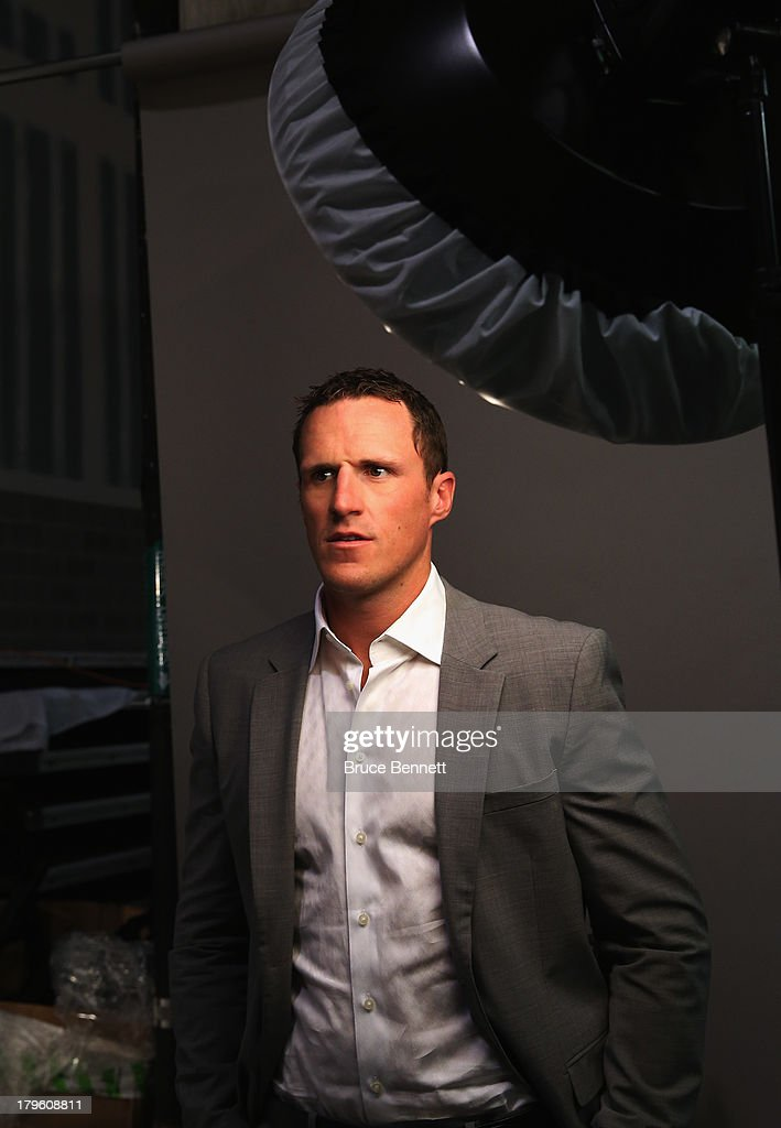Dion Phaneuf of the Toronto Maple Leafs is photographed in a portrait session during the National Hockey League Player Media Tour at the Prudential Center on September 5, 2013 in Newark City.