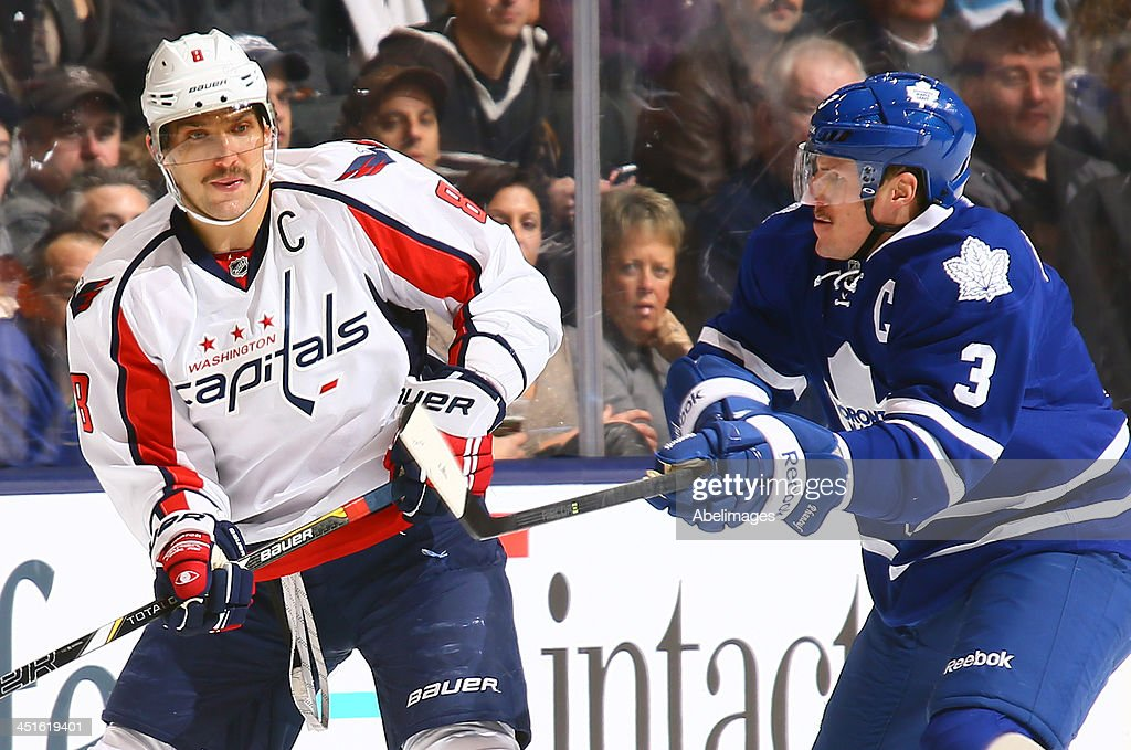 Dion Phaneuf #3 of the Toronto Maple Leafs lines up Alex Ovechkin #8 of the Washington Capitals during NHL action at the Air Canada Centre November 23, 2013 in Toronto, Ontario, Canada.