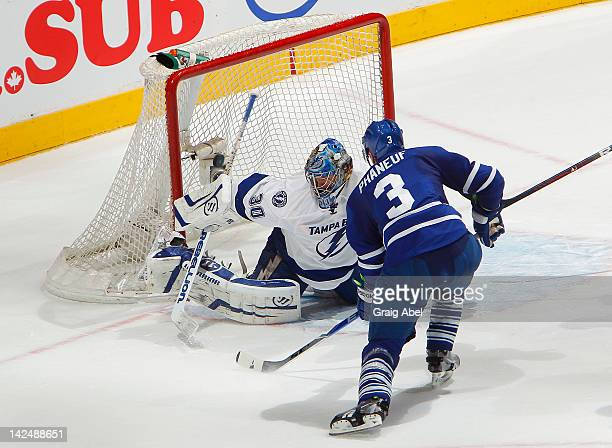 Dion Phaneuf of the Toronto Maple Leafs scores an overtime game winning goal on Dwayne Roloson of the Tampa Bay Lightning during NHL game action...