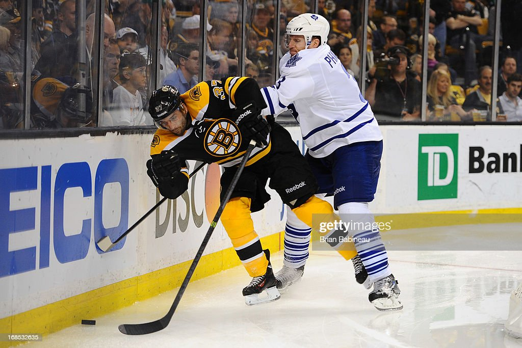 <a gi-track='captionPersonalityLinkClicked' href=/galleries/search?phrase=Dion+Phaneuf&family=editorial&specificpeople=545455 ng-click='$event.stopPropagation()'>Dion Phaneuf</a> #3 of the Toronto Maple Leafs shoves <a gi-track='captionPersonalityLinkClicked' href=/galleries/search?phrase=Patrice+Bergeron&family=editorial&specificpeople=204162 ng-click='$event.stopPropagation()'>Patrice Bergeron</a> #37 of the Boston Bruins in Game Five of the Eastern Conference Quarterfinals during the 2013 NHL Stanley Cup Playoffs at TD Garden on May 10, 2013 in Boston, Massachusetts.