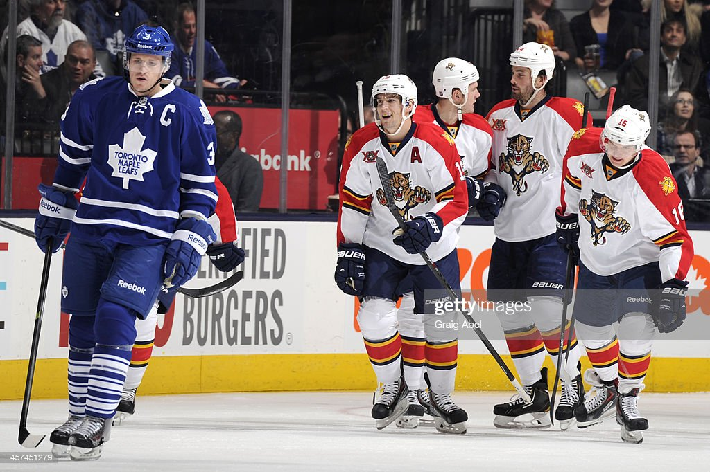 <a gi-track='captionPersonalityLinkClicked' href=/galleries/search?phrase=Dion+Phaneuf&family=editorial&specificpeople=545455 ng-click='$event.stopPropagation()'>Dion Phaneuf</a> #3 of the Toronto Maple Leafs skates away as <a gi-track='captionPersonalityLinkClicked' href=/galleries/search?phrase=Tomas+Fleischmann&family=editorial&specificpeople=554398 ng-click='$event.stopPropagation()'>Tomas Fleischmann</a> #14 of the Florida Panthers celebrates a first period goal with teammates during NHL game action December 17, 2013 at the Air Canada Centre in Toronto, Ontario, Canada.