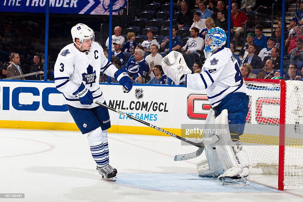 <a gi-track='captionPersonalityLinkClicked' href=/galleries/search?phrase=Dion+Phaneuf&family=editorial&specificpeople=545455 ng-click='$event.stopPropagation()'>Dion Phaneuf</a> #3 of the Toronto Maple Leafs skates up to Jussi Rynnas #40 of the Toronto Maple Leafs during the third period of the game against the Tampa Bay Lightning at the Tampa Bay Times Forum on February 19, 2013 in Tampa, Florida.