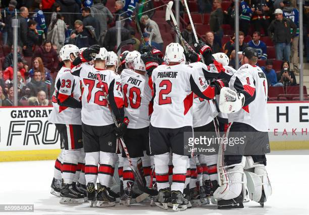 Dion Phaneuf Tom Pyatt and Thomas Chabot of the Ottawa Senators celebrate with teammates after winning their NHL game against the Vancouver Canucks...