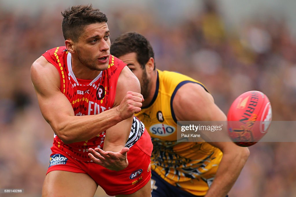 Dion Prestia of the Suns handballs during the round 10 AFL match between the West Coast Eagles and the Gold Coast Suns at Domain Stadium on May 29, 2016 in Perth, Australia.