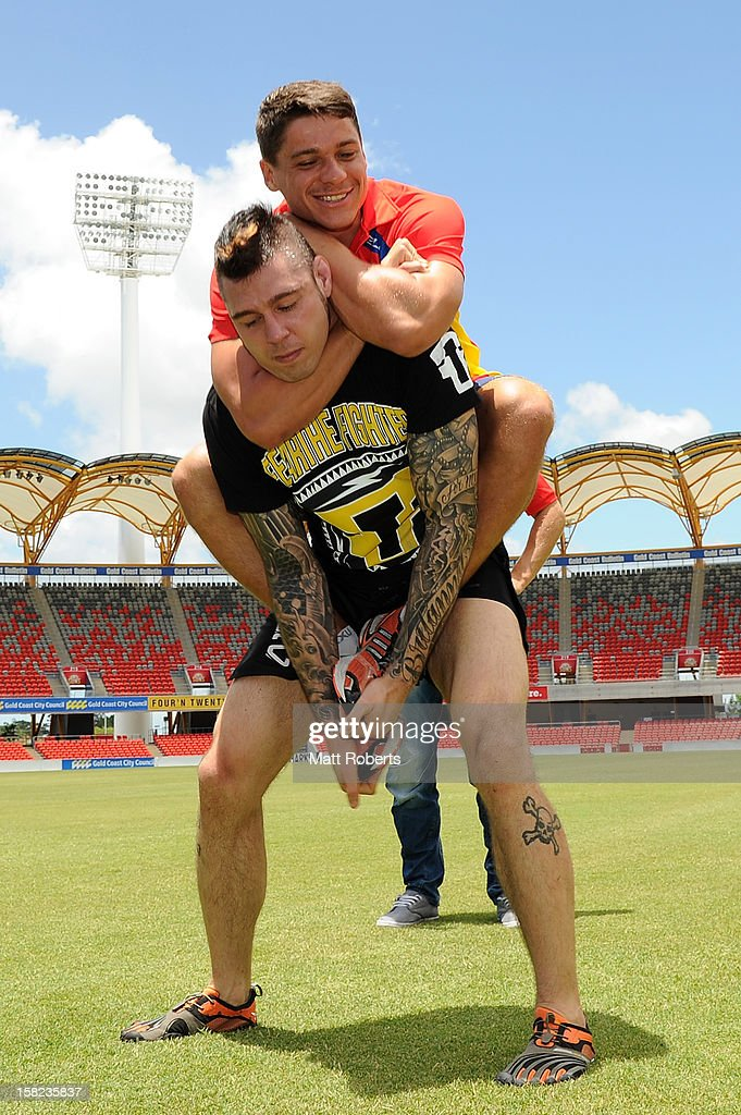 Dion Prestia of the Suns holds <a gi-track='captionPersonalityLinkClicked' href=/galleries/search?phrase=Dan+Hardy&family=editorial&specificpeople=5359879 ng-click='$event.stopPropagation()'>Dan Hardy</a> in a headlock during a UFC media session with the AFL Gold Coast Suns at Metricon Stadium on December 12, 2012 on the Gold Coast, Australia.