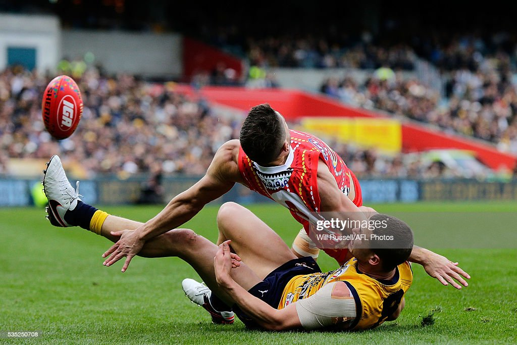 Dion Prestia of the Suns is tackled by <a gi-track='captionPersonalityLinkClicked' href=/galleries/search?phrase=Jack+Redden&family=editorial&specificpeople=5942332 ng-click='$event.stopPropagation()'>Jack Redden</a> of the Eagles during the round 10 AFL match between the West Coast Eagles and the Gold Coast Suns at Domain Stadium on May 29, 2016 in Perth, Australia.