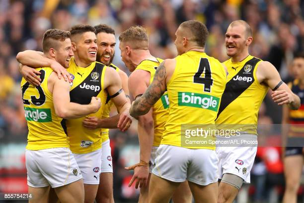 Dion Prestia of the Tigers celebrates kicking a goal with team mates during the 2017 AFL Grand Final match between the Adelaide Crows and the...