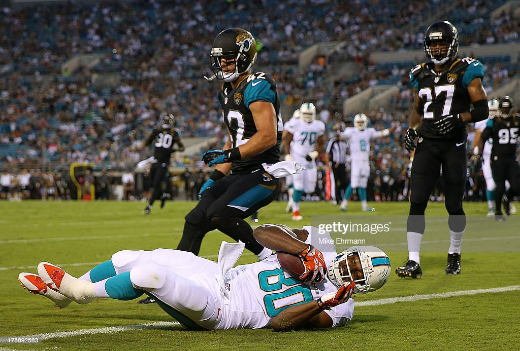Dion Sims #80 of the Miami Dolphins catches a pass during a preseason game against the Jacksonville Jaguars at EverBank Field on August 9, 2013 in Jacksonville, Florida.