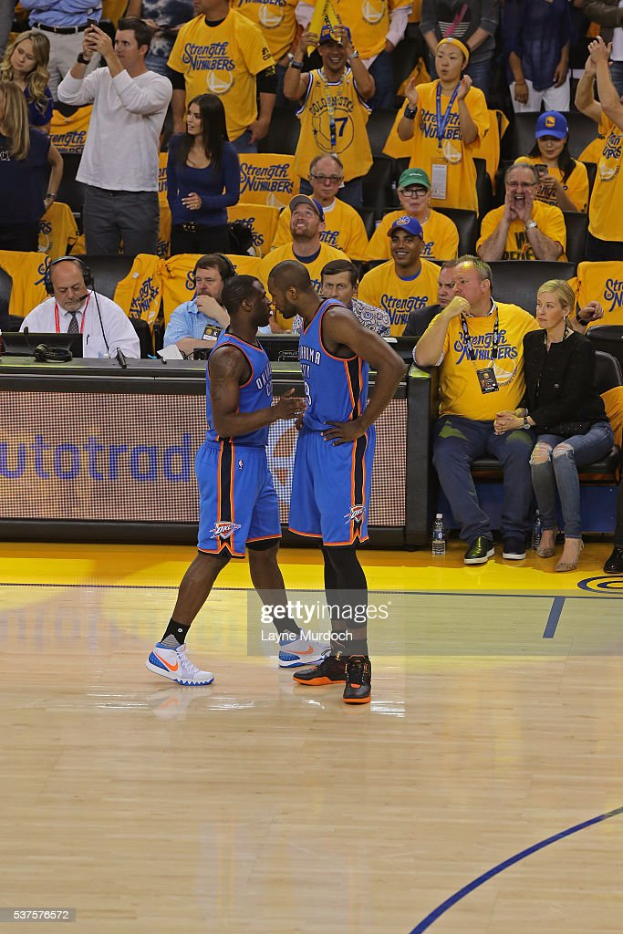 Dion Waiters and Serge Ibaka of the Oklahoma City Thunder talk in Game Five of the Western Conference Finals against the Golden State Warriors during...