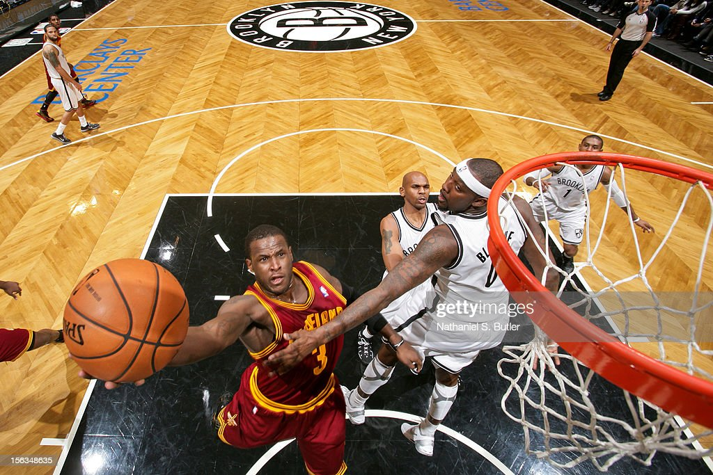Dion Waiters #3 of the Cleveland Cavalier shoots a layup against Andray Blatche #0 of the Brooklyn Nets on November 13, 2012 at the Barclays Center in the Brooklyn Borough of New York City.